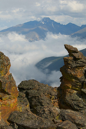 Photo by Walt Hester<br /> Longs Peak looms above clouds and Rock Cut on Thursday. The low clouds gave way to some sunshine at about timberline.
