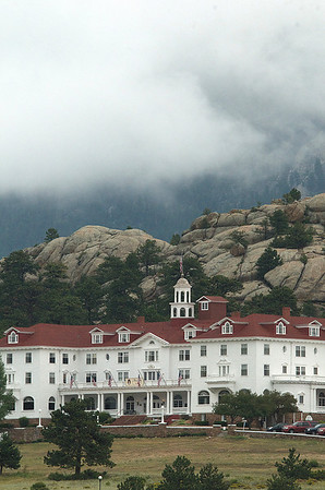 Photo by Walt Hester<br /> Clouds pile up in the Black Canyon behing the Stanley Hotel on Thursday.