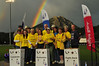 Photo by Walt Hester<br /> Once again, skies cleared enough for a rainbow to appear over the gold-clad and gold-hearted Leadership Team during the opening of the Relay for Life. The Estes Park Relay for Life is one of the top money raisers in the state, gathering close to $33,000.