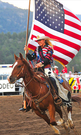 Miss Rodeo America 2009, Maegan Ridley, carries the Flag around Granny May Arena to start the 2009 Rooftop Rodeo on Tuesday night. Ridley hails from Alta Loma, Calif. Photo by Walt Hester