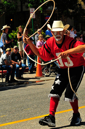 Rodeo clown J.J. Harrison prepares to rope an interloper during the Rooftop Rodeo Parade on Tuesday morning. The parade marks the start of Rooftop Rodeo week, with a rodeo every evening through Sunday begining with a pre-rodeo show at 7 p.m. at the Stanley Fair Grounds. Photo by Walt Hester.