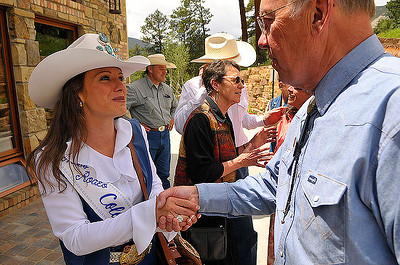 Audra Dobbs, the 2009 Miss Rodeo Colorado, meets Estes Park Mayor Bill Pinkham at the Rooftop Rodeo Queen's Luchen on Tuesday. The rodeo, which began on Tuesday, will continue nightly through Sunday at the Stanley Fair Grounds. Photo by Walt Hester.
