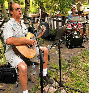 Photo by Walt Hester Musicians Dave Gandol, left, and Steve Jackson perform for visitors to Glen Haven on Saturday. While the musicians were playing at a local shop, they could be heard all down the main street.