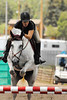 """Photo by Walt Hester<br /> Nina Tipton guides her hourse """"Cueball"""" through the course during Saturday's Adult Amature Jumper competition at the Copper Panny Horse Show. Last week marked the start of a month of jumping horse shows at the Stanley Fairgrounds."""