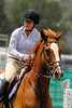 "Photo by Walt Hester<br /> Nina Tipton guides her hourse ""Cueball"" through the course during Saturday's Adult Amature Jumper competition at the Copper Panny Horse Show. Last week marked the start of a month of jumping horse shows at the Stanley Fairgrounds."