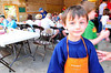 Photo by Walt Hester<br /> Gabrial Housewright is dressed for work at the pancake breakfast. Gabe's father, Tom, is a former fire chief.