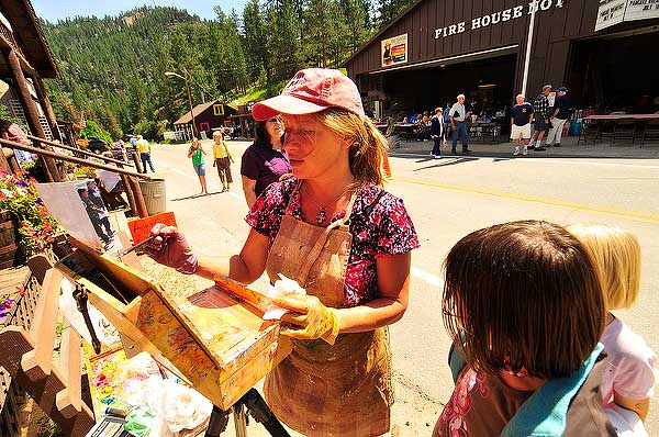 Photo by Walt Hester<br /> Local artist Dawn Normali paints outside the Glen Haven Art and Crafts Show on Saturday. While for some the weekned was all about the fire department and the pancakes, the art and crafts show, which runs in conjunction with the fire department's fundraiser, was the big draw.