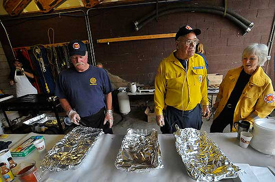 Photo by Walt Hester<br /> From left; Jim Broomfield, Bob Lindsay and Sue Keefe wait for donor/diners at the Glen Haven firehouse during the annual fundraiser pancake breakfast on Saturday. The event helps fund the small all-volunteer fire department northeast of Estes Park.