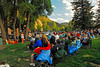 Photo by Walt Hester<br /> Cowboy Brad Fitch entertains a crowd gathered in Bond Park on Monday evening. Fitch and his campfire sing-along are a summer time fixture in Bond Park