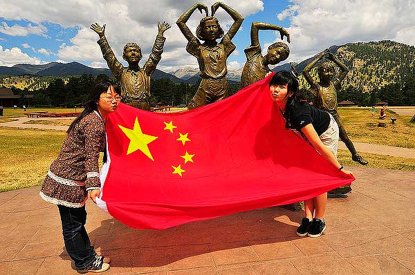 Nian Yang, left, and Nikang Ouyang send love from China at the YMCA of the Rockies on Wednesday.