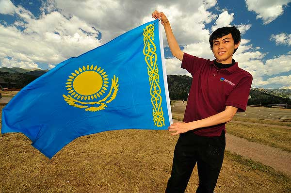 Rauan Toretay displays the steppe eagle and sun of Kazakhstan, his home. The YMCA of the Rockies will celebrate the nations of its multi-cultural staff during its International Festival on Wednesday, July 30.