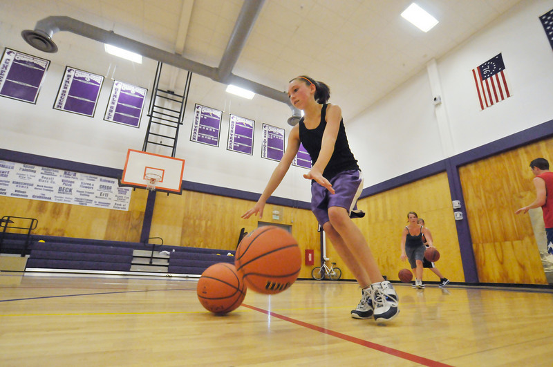Photo by Walt Hester<br /> Bizzy Palmer, 13, tries to dribble two basketballs at once during summer practice for Estes Park girls basketball on Thursday. Many different sports have started summer skills practices at the high school.