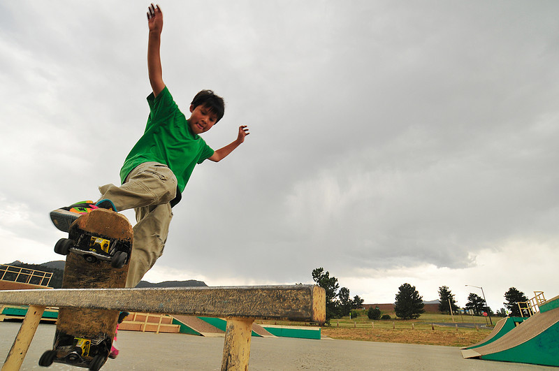 Photo by Walt Hester<br /> Tully Kelly of Estes Park, 10, rides his skateboard along a rail at the Estes Vally Skate Park on Thursday.