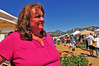 Photo by Walt Hester<br /> Vickie Dennis has a smile for both customers and vendors at the market. In spite of new ownership and a new location, Dennis has helped the Estes Valley Farmers' Market thrive.