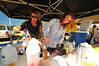 Photo by Walt Hester<br /> Mary, left, and Mandy McClinetock mix up smoothies for patrons of the market. Coffee, smoothies, salsa and even music fill the market.