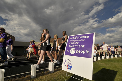 Photo by Walt Hester Estes Park High School cheerleaders lend their support at last year's Relay for Life. The annual event returns to Bobcat Stadium beginning Friday night.