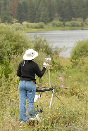 Photo by Walt Hester<br /> Carol Andreyev, a summer resident of Estes Park, paints at Lily Lake on Wednesday.