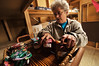 Photo by Walt Hester<br /> Kerrie Badertscher arranges homemade jelly before the annual Hilltop Guild Bazaar east of Allenspark on Highway 7. The event raises money for the guilds many philanthropic causes.