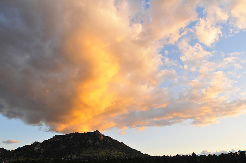 Photo by Walt Hester<br /> The bright, colorful clouds of Tuesday's sunrise seem to make a volcano out of Prospect mountain.
