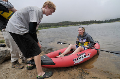 Photo by Walt Hester Matthew Fonken, 15, pushes his sister, Elizabeth, 17, into Lily Lake on Wednesday.
