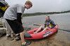 Photo by Walt Hester<br /> Matthew Fonken, 15, pushes his sister, Elizabeth, 17, into Lily Lake on Wednesday.
