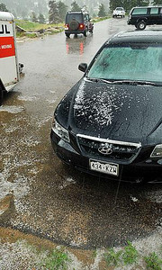 Hard water Pebble-size hail stones cover a parking lot and car along Elm Road on Monday. Photo by Walt Hester