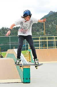Going down Chris Vogt, 15, of Estes Park slides along in the Estes Valley Youth Centers skate park on Saturday. Vogt was the winner on Saturday of the High School division of the skateboard competition sponsered by the Estes Park Police. Photo by Walt Hester