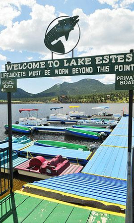 The Lake Estes Marina's fleet of rental watercraft — and the lake's trout — await the start of the 23rd Lake Estes Fishing Derby tomorrow. Photo by Walt Hester