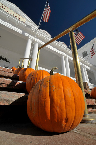 Photo by Walt Hester<br /> Pumpkins decorate the front stairs of the Stanley Hotel on Saturday.
