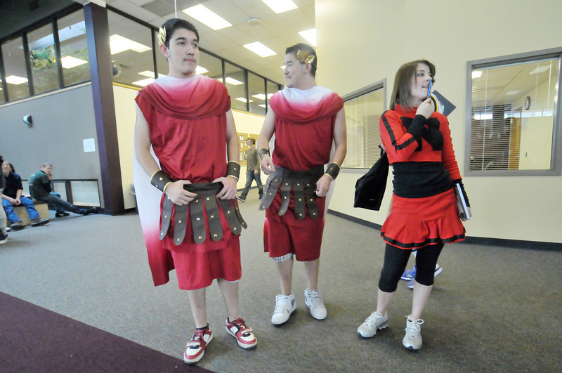 Photo by Walt Hester<br /> Miguel and Javier Tapia, dressed as Roman soldiers, and Alyssa Atkins await the vote of classmates last Thursday during a costume contest. The Tapias won the round.