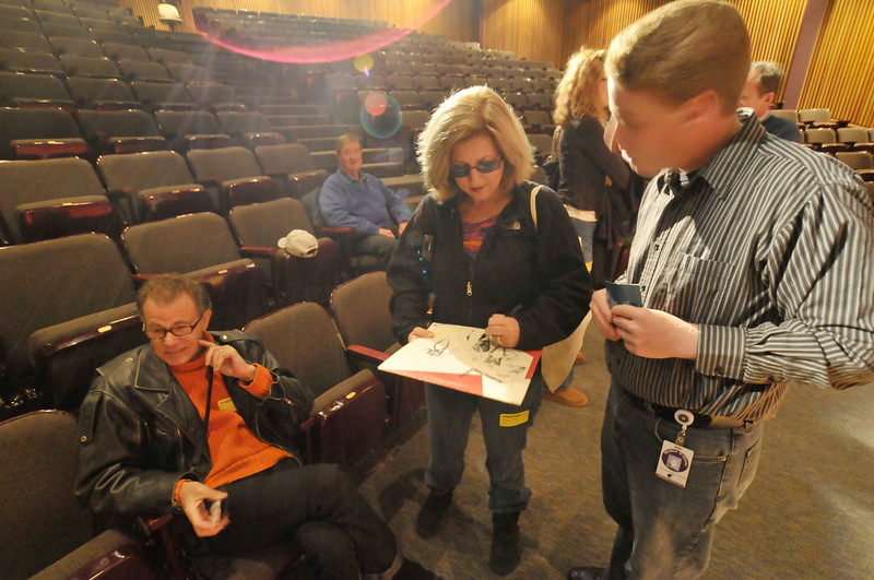 Photo by Walt Hester<br /> Alan Paul relaxes as fellow Manhattan Transfer member Janis Siegel autographs an album cover before speaking to Estes Park High School singers on Thursday, Oct. 29 at the school's auditorium. The vocal group has been together since the early 70's and were in Fort Collins to perform.