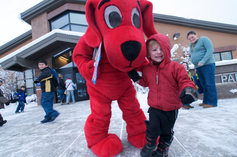 Photo by Walt Hester<br /> Justin Marquart, 2, smiles broadly after hugging Clifford, the Big Red Dog in front of the Estes Park Elementary School on Thursday. Clifford's appearence was part of the schools annual Scholastic Book Fair.