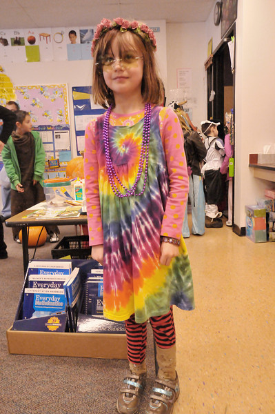 Photo by Walt Hester<br /> Abbie Housewright looks groovy on Thursday during the Estes Park Elementary School's Fall Festival.