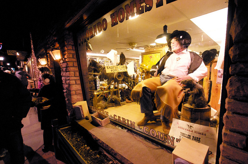 Photo by Walt Hester<br /> The talk of the night was of Michael Jackson performing in the window of Colorado Homestead. He performed variation on several famous dances for the assembled spooks and princesses.