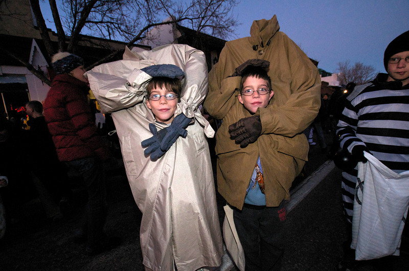 Photo by Walt Hester<br /> Twins Luke and Colin Soguero, 10, hung on to their own heads on homemade outfits on Saturday night.