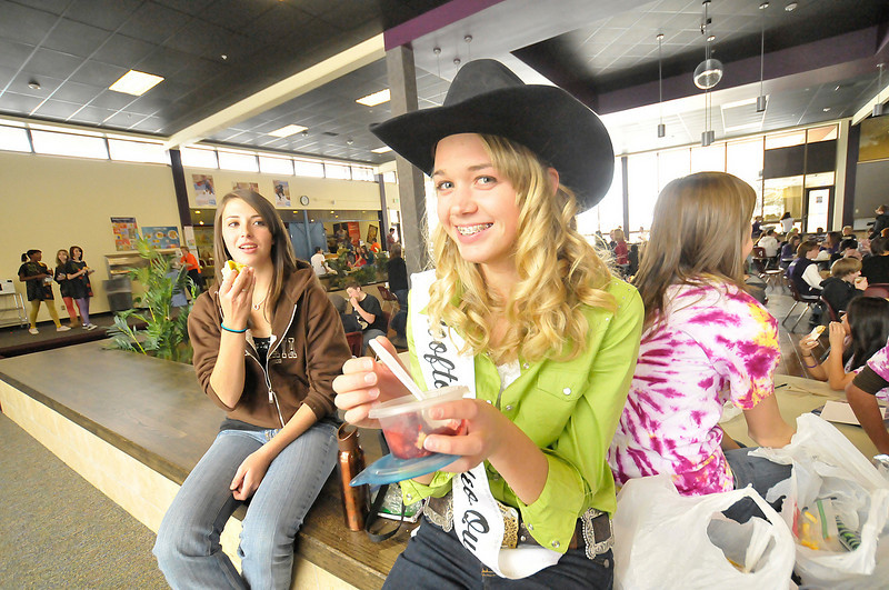 Photo by Walt Hester<br /> Marley Mardock, the Rooftop Rodeo Queen for 2010, enjoys lunch with friend Torrey Slininger, who is dressed as the Rooftop Rodeo Queen.