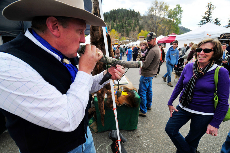 Photo by Walt Hester<br /> Brian Soliday of the Rocky Mountain Elk Foundation demonstrates a bull elk call for Carol Pitts of Colorado Springs on Saturday at Elk Fest.  Elk Fest featured not only elk calling demonstrations, but an elk calling contest open to pros and amatures, adults and children.