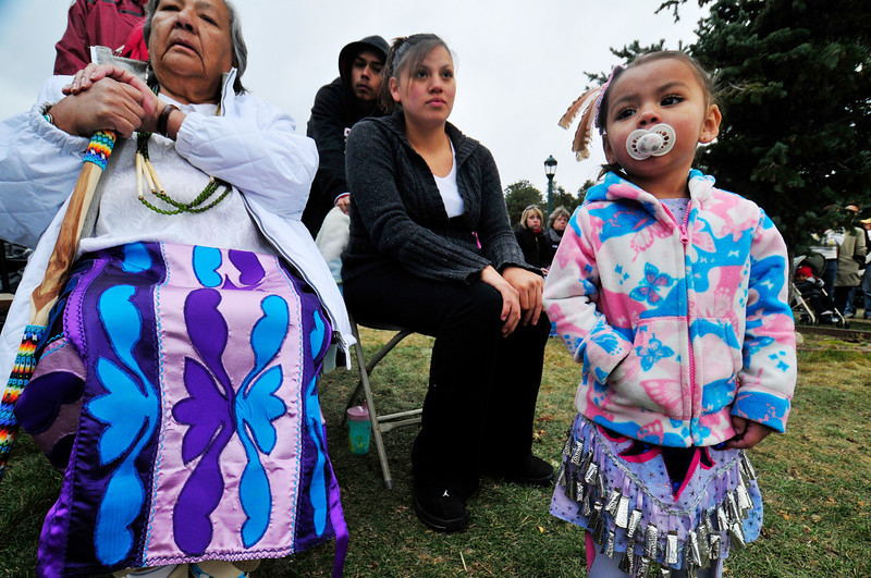 Photo by Walt Hester<br /> Audrey Wadena, Starla and Lynae Mulluk, 16 months, all of Fort Collins, watch friends and family during a Native American dance demonstration at Elk Fest on Saturday. The last of Estes Park's fall festivals continued to grow this year, attracting many visitors to the annuual event, and selling out the elk viewing tours on Saturday.