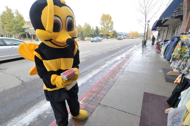 "Photo by Walt Hester<br /> A friendly bee greets visitors to the annual ""Surprise"" sidewalk sale along Elkhorn Avenue on Saturday."