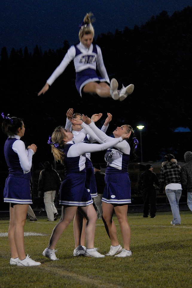 Photo by Walt Hester<br /> Cheerleaders perform before Friday's Homecoming game at Bobcat Stadium. The girls performed in the traditional uniforms in spite of temperatures in the 20s.