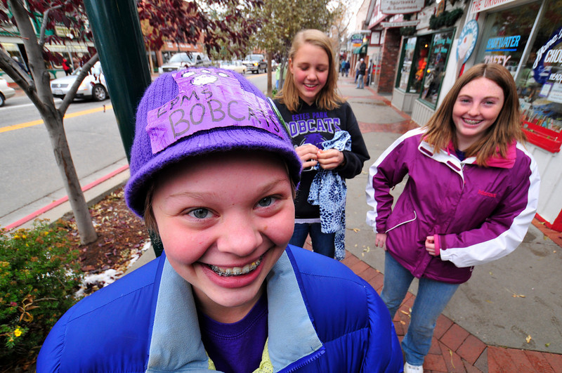 Photo by Walt Hester<br /> Estes Park Middle School student Jenna Marshall, 13, wears her loyalty on her hat on Elkhorn Avenue on Friday. Friday saw the annual Homecoming Parade on Elkhorn Avenue.