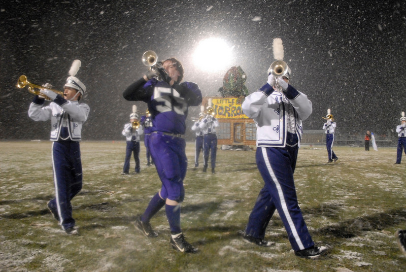 Photo by Walt Hester<br /> The Estes Park High School Marching Band plays at halftime of Friday's homecoming game in the midst of swirling snow and frigid temperatures. For more on the game, turn to Sports.