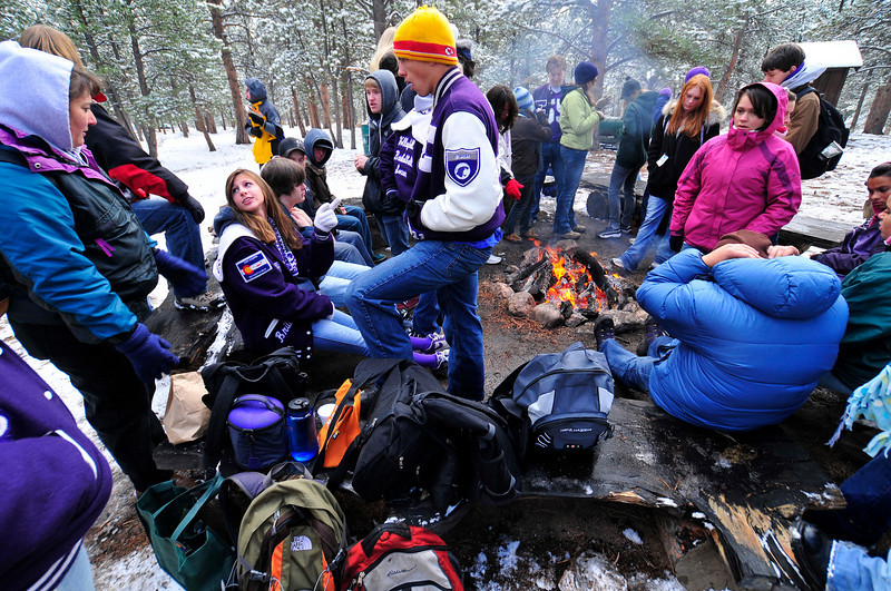 Photo by Walt Hester<br /> Estes Park students huddle around a fire between science stations at MacGregor Ranch on Friday. The Students as Scholars Institute took science students out to the ranch for hands-on demonstrations of ecological science tests.