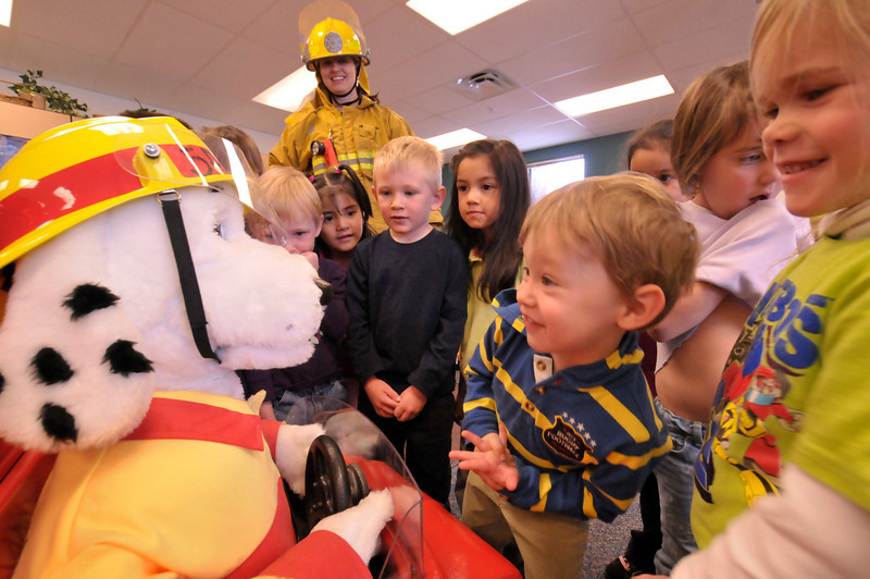 Photo by Walt Hester<br /> The Estes Park Fire Department's Sparky the fire dog meets preschoolers during Fire Safety Day at the Estes Park Elementary School on Thursday. Firefighters from surrounding communities also took part, explaining the importance of fire safety in the school