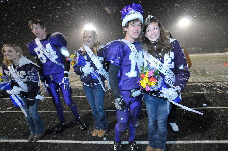 Photo by Walt Hester<br /> Caleb Hightower and Hannah Koschnitzke inor the snow in their moment of royalty as they are crowned Homecoming King and Queen for 2009 during halftime of Friday's game at Bobcat Stadium. Caleb is the Bobcats' starting quarterback and Hannah is a multiple letter winner, including for Academics.