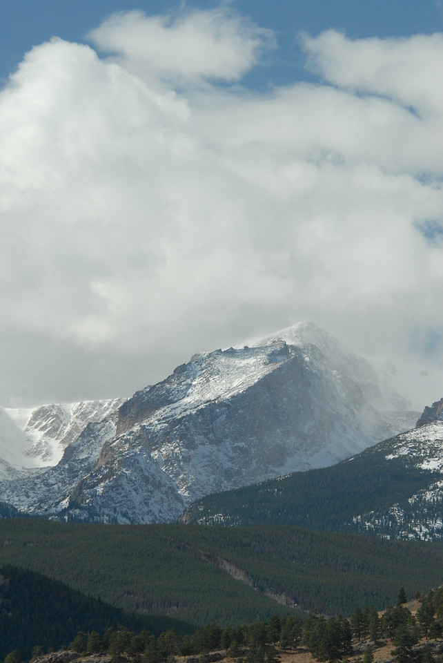 Photo by Walt Hester<br /> Clouds swirl and snow blows on and around Hallett Peak on Tuesday.
