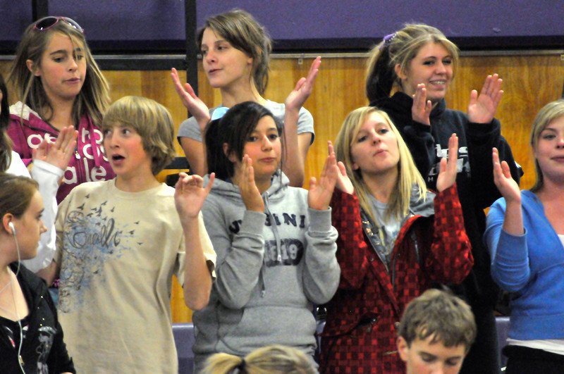 Photo by Walt Hester<br /> Cheerleaders and fans shout and chant at Tuesday's volleyball game between Estes Park's Ladycats and the Platte Valley Broncos. For more on the game, turn to Sports.