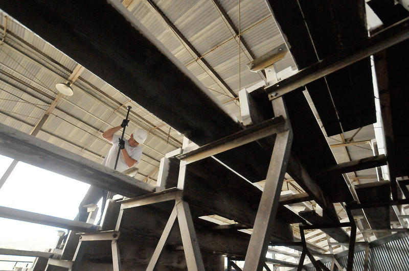 Photo by Walt Hester<br /> Lorenzo Amaya uses a pry bar to remove the bleachers from Granny May Arena at the Stanley Fairgrounds on Wednesday. The new grandstands will cost over $2 million and should be up and running by May, 2010.