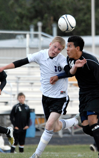 Photo by Walt Hester<br /> Estes Park forward __________ gets bumped off the ball during Tuesday's match against the Valley Vikings. Physical play and lots of near-misses resulted in a Bobcat loss; 2-1.