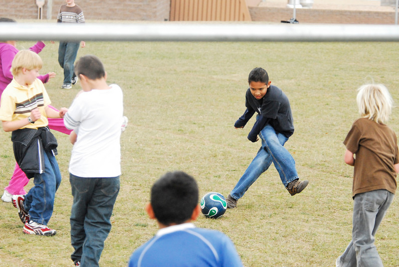 Photo by Walt Hester<br /> Estes Park Elementary School children plat soccer during recess at the school on Wednesday. With the shift in demographics and the rise in popularity among younger child-athletes, one is as likely to see soccer as American football on playgrounds in Estes Park, as well as the rest of the nation.